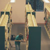 Library staff members shelving books in the new Reynolda Manor Branch Library, 1998.
