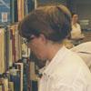 Librarian Jenny Barrett shelving books in the new Reynolda Manor Branch Library, 1998.