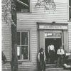 J. E. Mickey shop on South Main Street, with the coffee pot in front, 1899.
