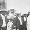 Thomas A. Edison, center in white coat, chats with Winston-Salem residents.