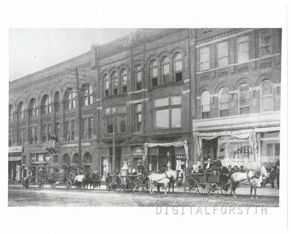 Winston Fire Department in front of buildings in the 300 block of North Liberty Street, 1899.