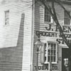 Joseph Renard florist and grocery store at the corner of Main Street and Fish Alley.