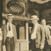 Men standing in front of the Elmont Theatre on Liberty Street.
