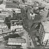 Aerial of the downtown area looking east, with East Third Street at right and East Fourth Street at left, 1966.