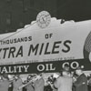 Quality Oil Company billboard on the southeast corner of West Fourth and Marshall Streets, 1949.