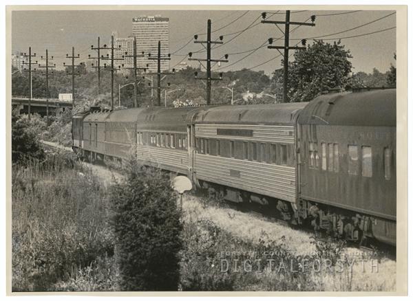 Southern Railway passenger train approaches First Street bridge on its way into Winston-Salem, 1970.