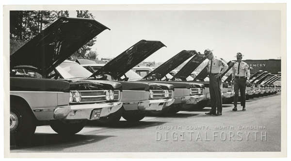 State Highway Patrol car inspection at the National Guard Armory on Link Road, 1969.
