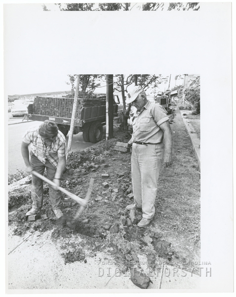 Bricks on Holly Avenue and Poplar Streets sidewalks, being removed, 1969.