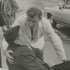 Edward J. Kennedy fell on the street near the Robert E. Lee Hotel, and an ambulance came with medical help, 1968.
