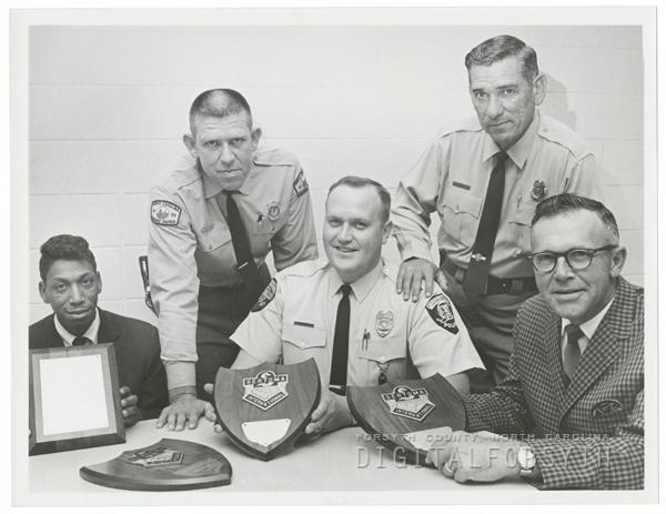 Men receiving plaques from Sertoma International.