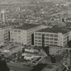 Aerial view of R. J. Reynolds Tobacco Company buildings looking east from the Reynolds Building, 1940.