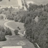 Aerial of Tanglewood Park, showing the swimming pool, tennis courts, Manor House, and stables, 1955.