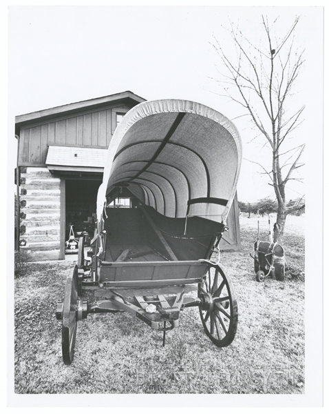A covered Nissen wagon in front of the Loyd house in King, 1967.