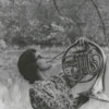 Nancy Brubaker playing the French horn, 1965.