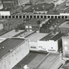 Aerial of the 400 block bordered by West Fourth (right), North Liberty (top), and West Fifth (left) Streets, 1963.