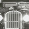 Alma R. Farmer with a 1932 Plymouth car, 1962.