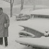 A snowy Sunday with cars covered after church, 1962.