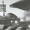 View of First Baptist Church across the parking lot in the snow, 1962.