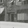 Walking in the snow on the corner of W. Fourth and Cherry Streets, 1962.