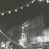 West Fourth Street at night with Christmas lights, 1954.