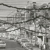 North Liberty Street with Christmas decorations and traffic after the Christmas parade, 1960.
