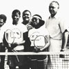 Coach Gaines on Tennis Court with National Youth Sports Young People