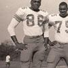 J. H. Miller & Three Football Players