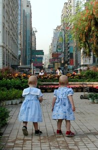 """The twins """"discovering"""" the wonders of Hong Kong at just over a year old."""