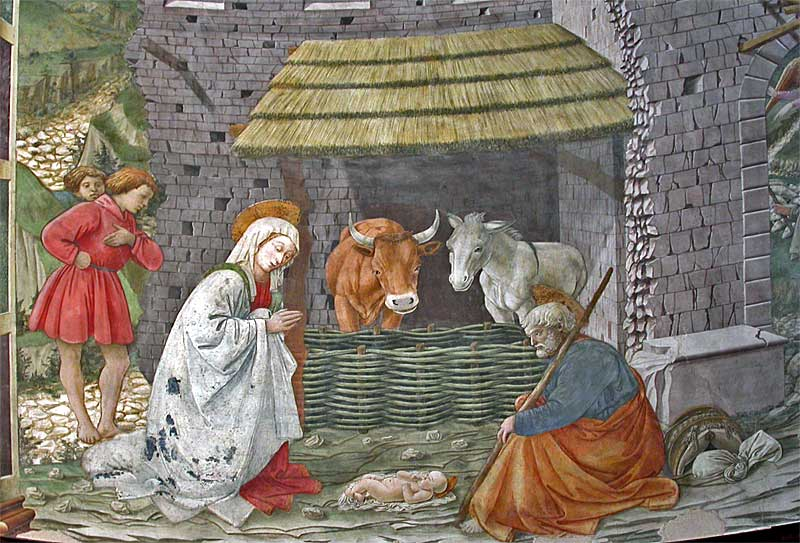 Image of Fra Filippo Lippi's Nativity scene showing Mary, Joseph, and the Christ child in a stable with a donkey and an ox
