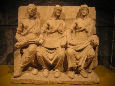 Terra cotta relief Three women, seated,
