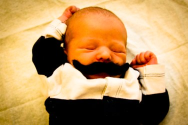 baby Moustache with a fist pump