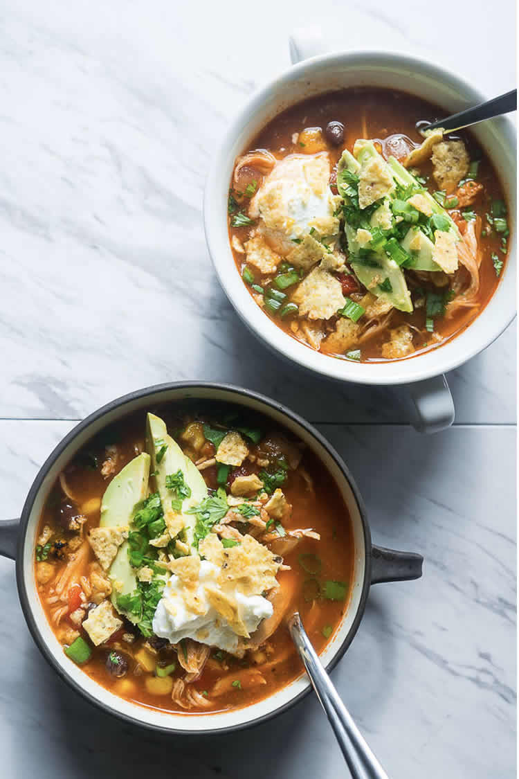 2 bowls filled with instant pot tortilla soup chicken avocado