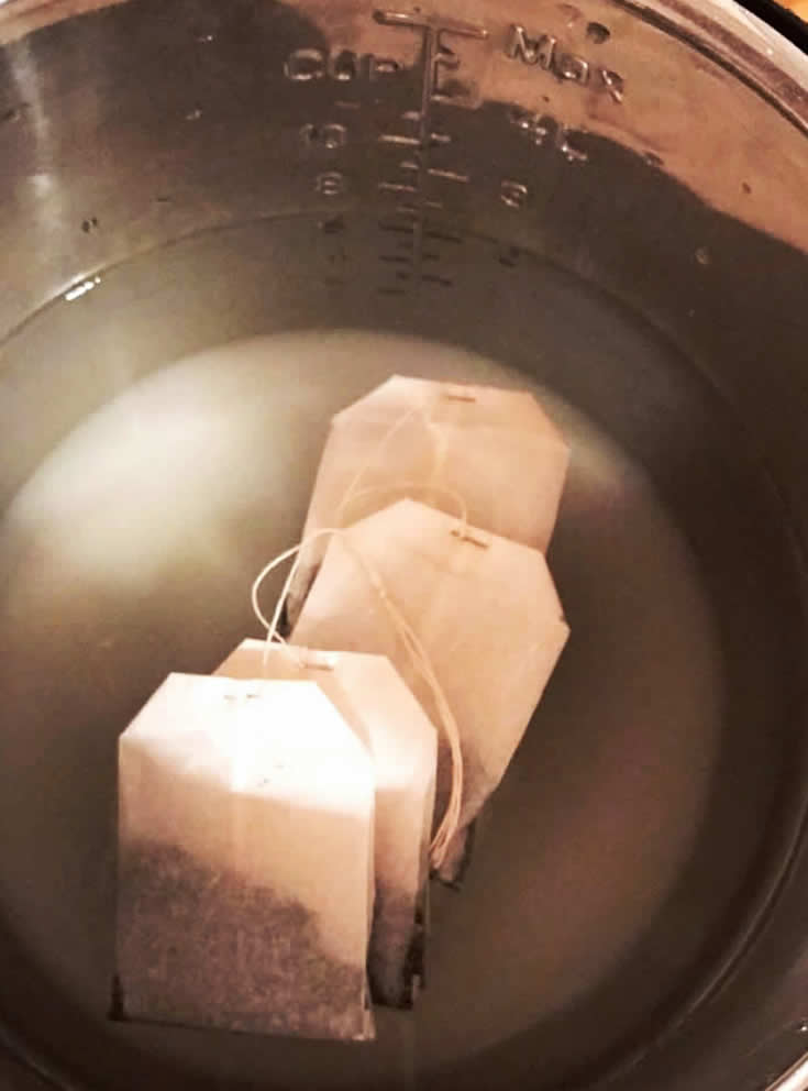 Learn how to make tea in your Instant Pot! We are sharing our favorite Instant Pot Tea recipe. Using just a few ingredients, your Instant Pot and a few minutes,  we will show you how to make Instant Pot sweet tea. Also we'll tell you how to make sure that your tea isn't bitter!  #tea #instantpot #recipes #instantpotrecipes #beverages