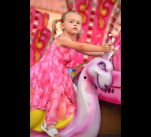 Girl on carousel