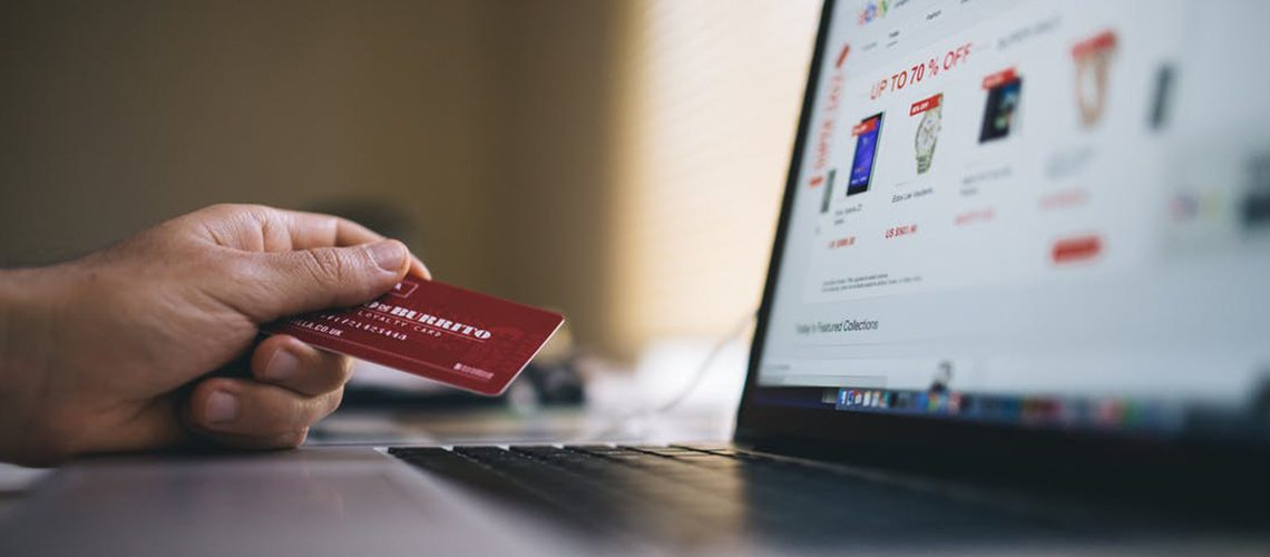 Person holding credit card, ready to use an ecommerce shop