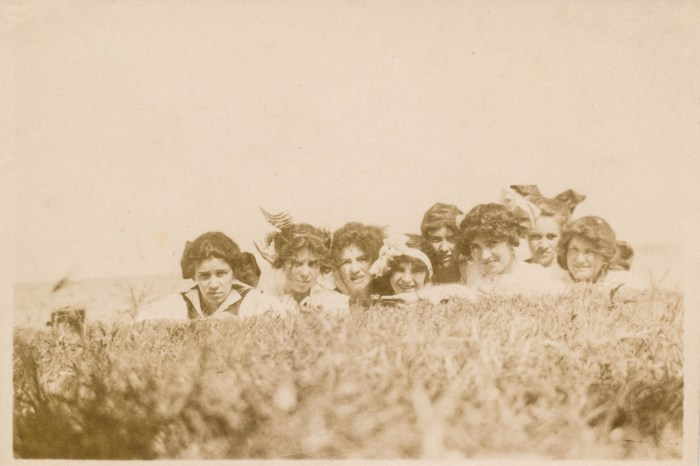 Group of women hiding in the grass - Undated