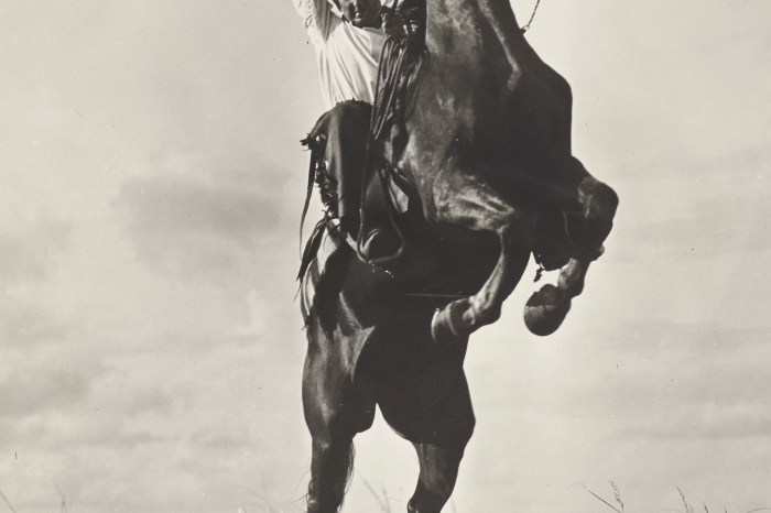 """Old faded image 3 - Erwin E. Smith (1886-1947) Photographer Erwin E. Smith riding a """"sunfisher"""" and he is not pulling leather, Bonham, Texas  1908 Gelatin silver print  Amon Carter Museum of American Art, Fort Worth, Texas, Bequest of Mary Alice Pettis   P1986.42.135"""