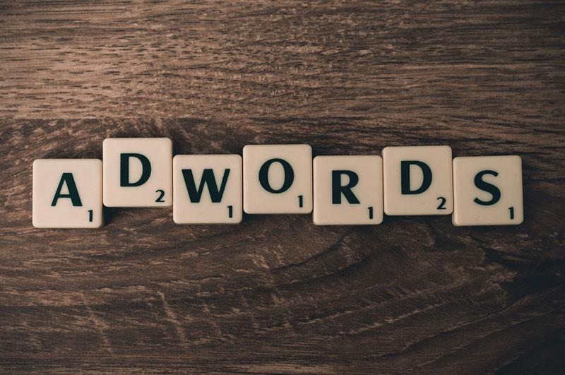 word adwords against dark wooden background