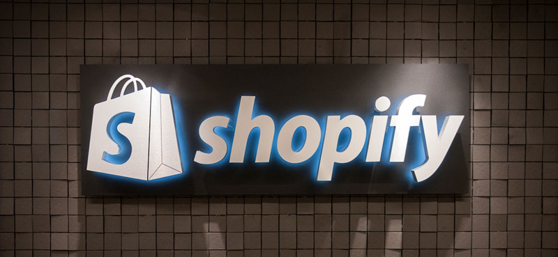shopify sign on the wall