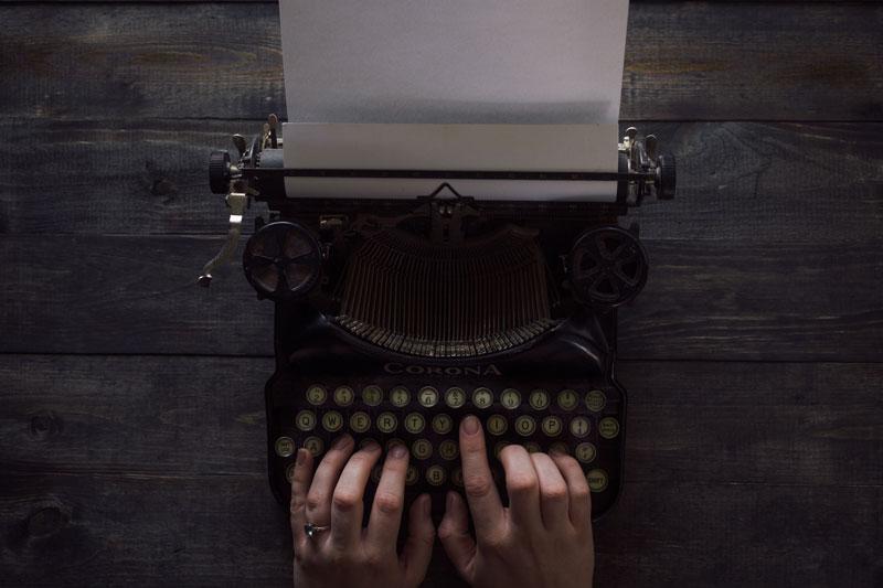 writing on typewriter machine