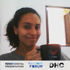 Ana holding a coffee cup and smiling for a Forum photo booth image