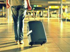 man walking suitcase