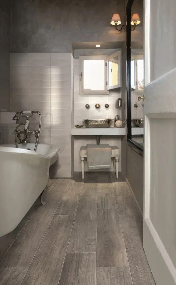 41 Cool Bathroom Floor Tiles Ideas You Should Try   DigsDigs wood imitating floor