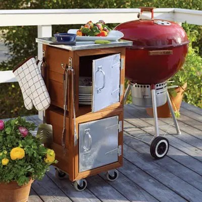 If a Weber BBQ is your whole outdoor kitchen than a storage unit on castors is a great company to it. You can easily move them both around your deck.
