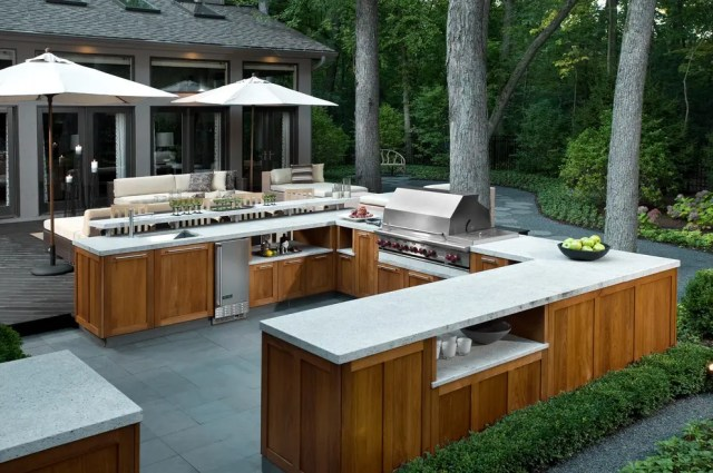 If you want a functional outdoor kitchen thank you thing about a large prep space, a sink, some storage space and even an outdoor refrigerator.