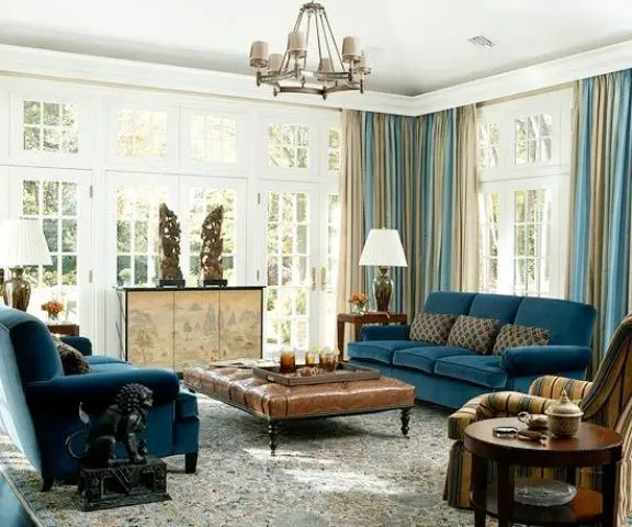 26 Cool Brown And Blue Living Room Designs   DigsDigs navy blue upholstery  blue and beige draperies  beige room decor and a rich  brown