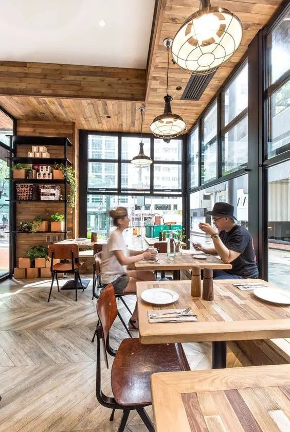 35 Cool Coffee Shop Interior Decor Ideas   DigsDigs modern coffee shop with interior clad with wood and interacting with the  street through large windows