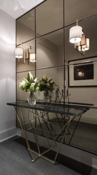 27 Gorgeous Wall Mirrors To Make A Statement   DigsDigs a smoked mirror wall  a geo base console make this entryway super modern  and eye