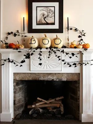 70 Great Halloween Mantel Decorating Ideas   DigsDigs Draw the letters B O O on a trio of pumpkins using a black marker  You can