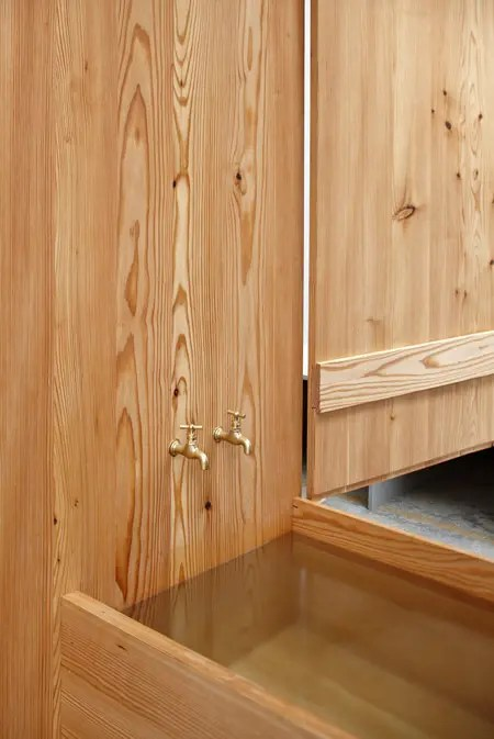 Larch Wood Wardrobe Combined With A Bathtub DigsDigs